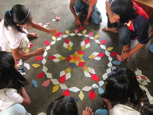 A simple mandala made from diamond cut used clothing in the village of Guina'ang in 2012.